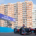 Jacques Villeneuve enters the pitlane at the picturesque Punta del Este beach circuit