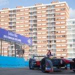 Jacques Villeneuve enters the pitlane at the picturesque Punta del Este beach circuit