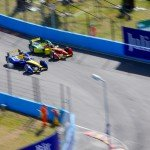 Sebastien Buemi passes Daniel Abt as the Swiss driver fights from fifth place on the grid to win the ePrix