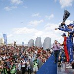 The top three celebrate on the rostrum situated on the Punta del Este beach