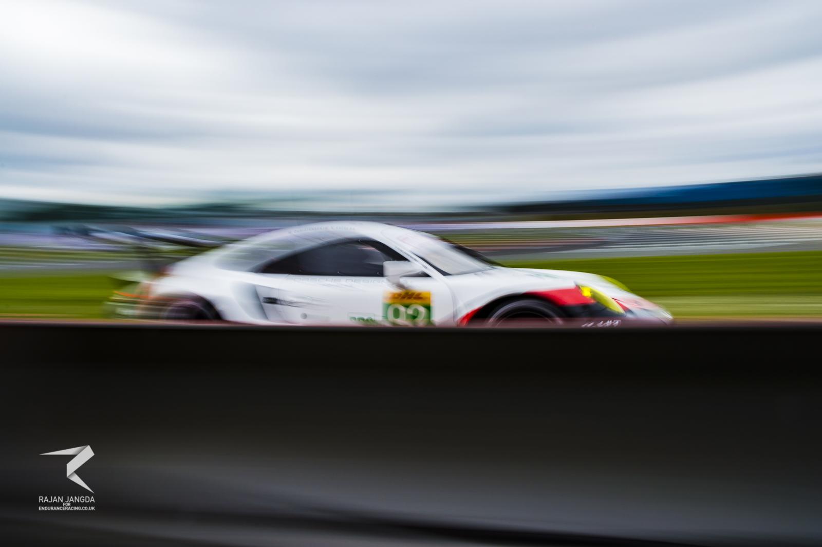 The #92 Porsche attacking the white line